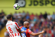 Glen Johnson of Stoke City (L) and Andros Townsend of Crystal Palace (C) both compete for the ball in the air during the Premier League match between Crystal Palace and Stoke City at Selhurst Park on September 18, 2016 in London, England.