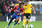 Jonny Otto of Wolverhampton Wanderers is challenged by Wilfried Zaha of Crystal Palace during the Premier League match between Crystal Palace and Wolverhampton Wanderers at Selhurst Park on October 6, 2018 in London, United Kingdom.