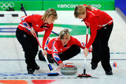 Eve Muirhead (C) of Great Britain and Northern Ireland releases the stone as Kelly Wood (L) and Lorna Vevers brush the ice during the women's curling round robin game between Great Britain and Switzerland on day 10 of the Vancouver 2010 Winter Olympics at Vancouver Olympic Centre on February 21, 2010 in Vancouver, Canada.