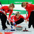 Kelly Wood Photos - Eve Muirhead (C) of Great Britain and Northern Ireland releases the stone as Kelly Wood (L) and Lorna Vevers brush the ice during the women's curling round robin game between Great Britain and Switzerland on day 10 of the Vancouver 2010 Winter Olympics at Vancouver Olympic Centre on February 21, 2010 in Vancouver, Canada. - Curling - Day 10