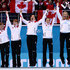 Kirsten Wall Photos - Gold medalists Jennifer Jones (R), Kaitlyn Lawes (2nd R), Jill Officer (C), Dawn McEwen (2nd L) and Kirsten Wall (L) of Canada celebrate during the flower ceremony for the Gold medal match between Sweden and Canada on day 13 of the Sochi 2014 Winter Olympics at Ice Cube Curling Center on February 20, 2014 in Sochi, Russia. - Winter Olympics: Curling