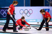 Eve Muirhead of Great Britain (C) plays the final stone alongside Claire Hamilton (L) and Vicki Adams (R) during the Bronze medal match between Switzerland and Great Britain on day 13 of the Sochi 2014 Winter Olympics at Ice Cube Curling Center on February 20, 2014 in Sochi, Russia.