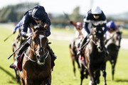 Ryan Moore riding Flag Of Honour (L) win The Comer Group International Irish St. Leger at Curragh Racecourse on September 16, 2018 in Kildare, Ireland.