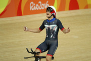 Steven Burke of Team Great Britain celebrates winning the gold medal after the Men's Team Pursuit Final for Gold on Day 7 of the Rio 2016 Olympic Games at the Rio Olympic Velodrome on August 12, 2016 in Rio de Janeiro, Brazil.