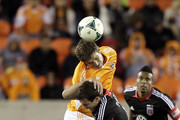 Bobby Boswell #32 of the Houston Dynamo goes over the top of Chris Pontius #13 of the D.C. United for a header during second half action at BBVA Compass Stadium on March 2, 2013 in Houston, Texas. Houston won 2-0.