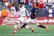Diego Fagundez #14 of New England Revolution defends Sean Franklin #5 of D.C. United during the first half at Gillette Stadium on March 12, 2016 in Foxboro, Massachusetts.