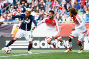 Sean Franklin #5 of D.C. United and Nick DeLeon #14 of D.C. United defend Lee Nguyen #24 of New England Revolution during the second half at Gillette Stadium on March 12, 2016 in Foxboro, Massachusetts. The Revolution tied the United 0-0.
