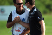 Justin Rose of England celebrates with his caddie Mark Fulcher after his birdie on the 18th hole during the final round of the DP World Tour Championship on the Earth Course at Jumeirah Golf Estates on November 25, 2012 in Dubai, United Arab Emirates.
