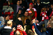 Whitehawk manager Steve King celebrates the teams late draw with the fans in the stand during the Emirates FA Cup Second Round match between Dagenham & Redbridge and Whitehawk at The Chigwell Construction Stadium on December 06, 2015 in Dagenham, England.