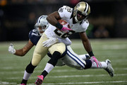C.J. Spiller #28 of the New Orleans Saints runs the ball for a first down during the fourth quarter against the Dallas Cowboys at Mercedes-Benz Superdome on October 4, 2015 in New Orleans, Louisiana.