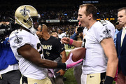 C.J. Spiller #28 hands the touchdown ball to Drew Brees #9 of the New Orleans Saints during overtime against the Dallas Cowboys at the Mercedes-Benz Superdome on October 4, 2015 in New Orleans, Louisiana.  The touchdown pass was his 400th career touchdown pass.