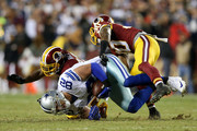 Tight end Jason Witten #82 of the Dallas Cowboys is tackled by strong safety Kyshoen Jarrett #30 and cornerback DeAngelo Hall #23 of the Washington Redskins in the second quarter at FedExField on December 7, 2015 in Landover, Maryland.