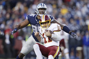 David Irving #95 of the Dallas Cowboys sacks Alex Smith #11 of the Washington Redskins in the third quarter of the game at FedExField on October 21, 2018 in Landover, Maryland. The Redskins won 20-17.
