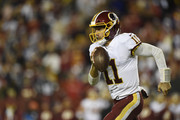 Quarterback Alex Smith #11 of the Washington Redskins scrambles with the ball in the fourth quarter against the Dallas Cowboys at FedExField on October 21, 2018 in Landover, Maryland.