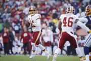 Alex Smith #11 of the Washington Redskins looks to pass the ball in the first quarter of the game against the Dallas Cowboys at FedExField on October 21, 2018 in Landover, Maryland.
