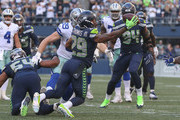 Free safety Earl Thomas #29 of the Seattle Seahawks intercepts a pass against tight end Blake Jarwin #89 of the Dallas Cowboys in the fourth quarter at CenturyLink Field on September 23, 2018 in Seattle, Washington.