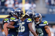 Safety Earl Thomas #29 of the Seattle Seahawks celebrates an interception with Cornerback Shaquill Griffin #26 during the second half  against the Dallas Cowboys at CenturyLink Field on September 23, 2018 in Seattle, Washington.