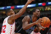 Harrison Barnes #40 of the Dallas Mavericks drives past Kris Dunn #32 of the Chicago Bulls at the United Center on March 2, 2018 in Chicago, Illinois. NOTE TO USER: User expressly acknowledges and agrees that, by downloading and or using this photograph, User is consenting to the terms and conditions of the Getty Images License Agreement.