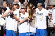 (L-R) Dirk Nowitzki #41, Jason Kidd #2, Jason Terry #31 and Shawn Marion #0 of the Dallas Mavericks celebrate with the Larry O'Brien trophy after they won 105-95 against the Miami Heat in Game Six of the 2011 NBA Finals at American Airlines Arena on June 12, 2011 in Miami, Florida. NOTE TO USER: User expressly acknowledges and agrees that, by downloading and/or using this Photograph, user is consenting to the terms and conditions of the Getty Images License Agreement.