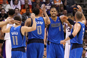 Tyson Chandler #6 of the Dallas Mavericks high fives teammates Jose Barea #11, Shawn Marion #0 and Jason Kidd #2 after scoring against the Phoenix Suns during the NBA game at US Airways Center on March 27, 2011 in Phoenix, Arizona. The Mavericks defeated the Suns 91-83.  NOTE TO USER: User expressly acknowledges and agrees that, by downloading and or using this photograph, User is consenting to the terms and conditions of the Getty Images License Agreement.