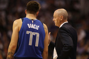 Head coach Rick Carlisle of the Dallas Mavericks talks with Luka Doncic #77 during the second half of the NBA game against the Phoenix Suns at Talking Stick Resort Arena on October 17, 2018 in Phoenix, Arizona.  The Suns defeated defeated the Mavericks 121-100.  NOTE TO USER: User expressly acknowledges and agrees that, by downloading and or using this photograph, User is consenting to the terms and conditions of the Getty Images License Agreement.