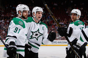 (L-R) Tyler Seguin #91, Jamie Benn #14 and Patrik Nemeth #15 of the Dallas Stars celebrate after Seguin scored a first period goal against the Arizona Coyotes during the NHL game at Gila River Arena on February 18, 2016 in Glendale, Arizona.