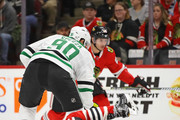 Connor Murphy #5 of the Chicago Blackhawks drops to block a shot by Jason Spezza #90 of the Dallas Stars at the United Center on February 8 2018 in Chicago, Illinois.