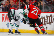 Jamie Benn #14 of the Dallas Stars defends against Kyle Palmieri #21 of the New Jersey Devils during the first period on October 16, 2018 at Prudential Center in Newark, New Jersey.