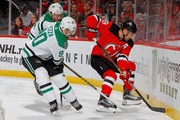 Taylor Hall #9 of the New Jersey Devils plays the puck during the second period against Jason Spezza #90 and Brett Ritchie #25 of the Dallas Stars on October 16, 2018 at Prudential Center in Newark, New Jersey.