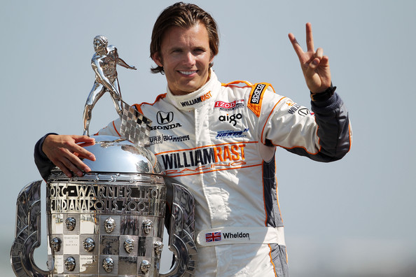Dan Wheldon Dan Wheldon of England, driver of the #98 William Rast-Curb/Big Machine Dallara Honda poses with Borg Warner Trophy on the yard of bricks during the 95th Indianapolis 500 Mile Race Trophy Presentation at Indianapolis Motor Speedway on May 30, 2011 in Indianapolis, Indiana.