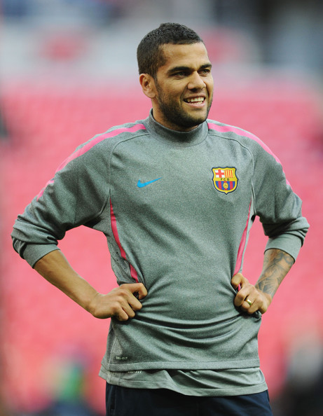 Daniel Alves Daniel Alves of FC Barcelona looks on during a Barcelona training session prior to the UEFA Champions League final versus Manchester United at Wembley Stadium on May 27, 2011 in London, England.