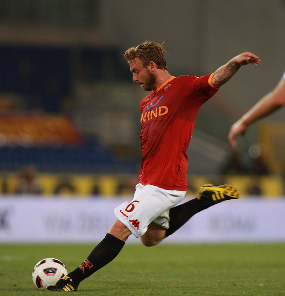 Daniele De Rossi Daniele De Rossi of AS Roma kicks the ball during the Serie A match between AS Roma and AC Cesena at Stadio Olimpico on August 28, 2010 in Rome, Italy.