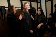 Edward Tricomi (L) prepares models backstage during the Dara Senders New York City Launch Presentation and Cocktail event on November 7, 2018 in New York City.