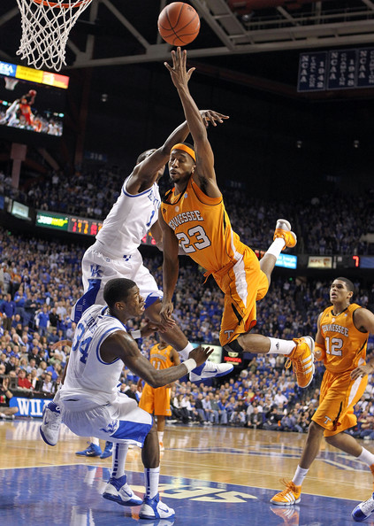Darius Miller Cameron Tatum #23 of the  Tennessee Volunteers shoots the ball while defended by Darius Miller #1 and DeAndre Liggins #34 during the SEC game against the Kentucky Wildcats at Rupp Arena on February 8, 2011 in Lexington, Kentucky.