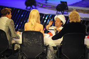 Jury members (L-R) Dieter Bohlen, Michelle Hunziker, and Thomas Gottschalk watch as Hammou Bensalah performs during the 'Das Supertalent' Finals on December 15, 2012 in Cologne, Germany.