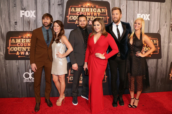 Arrivals at the American Country Countdown Awards [event,carpet,red carpet,premiere,little black dress,dress,flooring,award,american country countdown awards,l-r,lady antebellum,arrivals,dave haywood,chris tyrrell,singers,charles kelley,hillary scott,kelli cashiola]