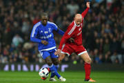 Clarence Seedorf of the Rest of the World and Nicky Butt of Great Britain and Ireland battle for the ball during the David Beckham Match for Children in aid of UNICEF between Great Britain & Ireland and Rest of the World at Old Trafford on November 14, 2015 in Manchester, England.