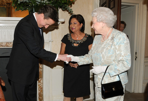 David Cameron Queen Elizabeth II meets Prime Minister David Cameron as Kamla Persad-Bissessar, Prime Minister of the Republic of Trinidad and Tobago (centre) looks on during the Commonwealth Day reception at Marlborough House, Pall Mall on March 14, 2011 in London.