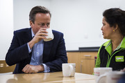British Prime Minister David Cameron (L) speaks to Asda employees during a visit to an Asda supermarket in Hayes on May 22, 2016 in London, England. Mr Cameron and politicians from different political parties are campaigning to remain in the European Union ahead of the EU referendum on June 23.