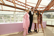 Jessica Gomes (R),  Tom Derickx (C), Dilone and Victoria Lee (L) during the Fashion Presentation at the David Jones SS19 Season Preview at the Sydney Opera House on August 08, 2019 in Sydney, Australia.