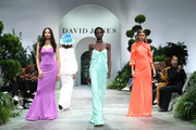 (L-R) Jessica Gomes, Adut Akech and Victoria Lee showcase designs during the media rehearsal ahead of the David Jones Spring Summer 18 Collections Launch at Fox Studios on August 8, 2018 in Sydney, Australia.