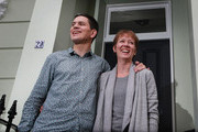 Former Foreign Secretary David Miliband and wife Louise pose for photographers on the steps of their home on September 29, 2010 in London, England. Mr Miliband is expected to announce his future plans later today, after losing in his bid to become the new Labour leader to his brother Ed Miliband.