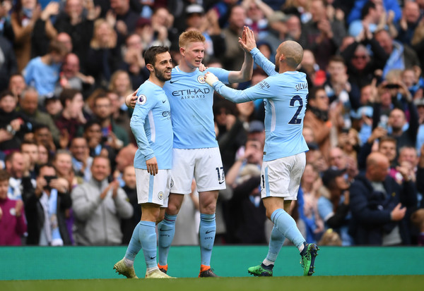 Manchester City v Swansea City - Premier League [player,sports,team sport,ball game,sport venue,football player,soccer player,sports equipment,product,championship,kevin de bruyne,bernardo silva,david silva,v,goal,side,manchester city,swansea city,premier league,match]