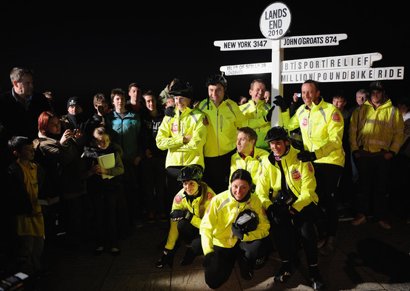 Sport Relief Celebrity Cycle Ride Reaches Lands End - Photocall [team,social group,yellow,event,high-visibility clothing,night,crew,recreation,tourism,miranda hart,russell howard,fearne cotton,davina mccall,patrick kielty,david walliams,sport relief celebrity cycle ride reaches lands end,finish line,lands end,sport relief million pound bike ride team]