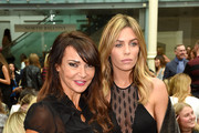 Lizzie Cundy (L) and Abbey Clancy attend the Julien Macdonald show during London Fashion Week Spring Summer 2015 at Somerset House on September 13, 2014 in London, England.
