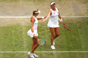 Timea Babos of Hungary and playing partner Kristina Mladenovic of France celebrate in their Ladies' Doubles semi-final match against Su-Wei Hsieh of Taiwan and Barbora Strycova of The Czech Republic during Day eleven of The Championships - Wimbledon 2019 at All England Lawn Tennis and Croquet Club on July 12, 2019 in London, England.