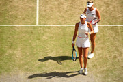 Timea Babos of Hungary, and playing partner Kristina Mladenovic of France look on in their Ladies' Doubles semi-final match against Su-Wei Hsieh of Taiwan and Barbora Strycova of The Czech Republic during Day eleven of The Championships - Wimbledon 2019 at All England Lawn Tennis and Croquet Club on July 12, 2019 in London, England.