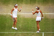 Timea Babos of Hungary, and playing partner Kristina Mladenovic of France celebrate in their Ladies' Doubles semi-final match against Su-Wei Hsieh of Taiwan and Barbora Strycova of The Czech Republic during Day eleven of The Championships - Wimbledon 2019 at All England Lawn Tennis and Croquet Club on July 12, 2019 in London, England.