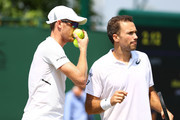 Bruno Soares (R) of Brazil and Jamie Murray (L) of Great Britain talk against Paolo Lorenzi of Italy and Albert Ramos-Vinolas of Spain during their Men's Doubles first round match on day five of the Wimbledon Lawn Tennis Championships at All England Lawn Tennis and Croquet Club on July 6, 2018 in London, England.