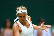 Sabine Lisicki of Germany plays a forehand against Christina McHale of USA in her Women's Singles Second Round match during day four of the Wimbledon Lawn Tennis Championships at the All England Lawn Tennis and Croquet Club on July 2, 2015 in London, England.